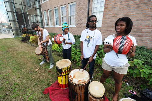 The KoumenKele African Dance & Drum Ensemble prepare for their performance with the Wharton K-8 school drummers