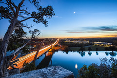 Pennybacker Bridge, Austin (Greg Annandale) Tags: park travel bridge blue sunset orange usa sun moon tree texture canon austin reflections river flow high texas arch traffic unitedstates infinity tx branches trails lighttrails bluehour hillcountry distance viewpoint 1740 austintx pennybackerbridge pennybacker canon5dmkii canon5dmk2