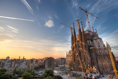La Sagrada Famlia (Greg Annandale) Tags: barcelona city travel family blue church yellow familia architecture sunrise canon golden early spain construction europe cathedral crane spires basilica balcony gothic catalonia cranes holy spanish gaudi gaud tall catalunya lasagradafamilia sagrada 1740 holyfamily lasagradafamlia canon5dmkii canon5dmk2