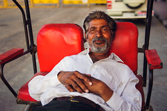 Rickshaw driver (DavidSciora) Tags: travel red portrait people india man face asia environmental driver rickshaw jaipur