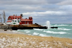 Point Betsie Lighthouse Crystalia, Michigan (Michigan Nut) Tags: winter sky usa lighthouse snow beach water clouds landscape midwest waves scenic landmark spray lakemichigan splash breakwall johnmccormick pointbetsielighthouse michigannutphotography