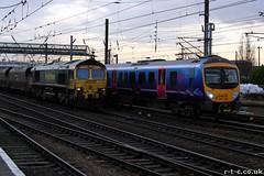 TransPennine 185 runs alongside 66515 (Tim R-T-C) Tags: railroad station train railway doncaster freighttrain eastcoastmainline mainline freightliner class66 ecml 1b74 class185 firsttranspennineexpress 66515 185128