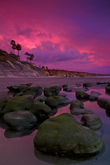 Pink Sky (Kodyak Eyeland) Tags: ocean california longexposure pink autumn sunset sea sky sun color green art beach nature water beauty rock clouds composition contrast canon photography photo amazing purple sandiego picture reef exposed 550d t2i