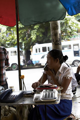 Phone Booth (Magne M) Tags: street woman female booth outdoors phone yangon streetlife parasol myanmar talking chatting