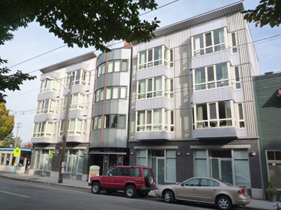 Planned 4-story apartment project to replace craft store, Capitol Hill Hair  on 19th Ave E