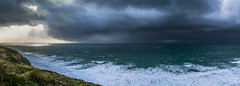 Wild (intrazome) Tags: ocean winter sea wild england cliff storm nature beautiful rain weather landscape coast nikon cornwall waves ray pano panoramic cliffs coastline rays wilderness sunrays storms d5100