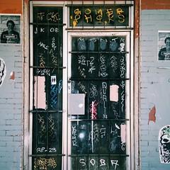 E. 6th St., Austin, TX (woody lauland) Tags: tags tagged door austin texas austintx atx tx graffiti streetart posters wheatpaste pasteups