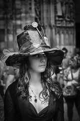 Fantasy, extravagance... (Periades) Tags: street blackandwhite bw woman girl hat blackwhite eyes noiretblanc candid femme streetphotography bijou nb yeux human chapeau rue fille cheveux photoderue yewels streethuman