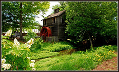 Grist Mill At Cannonsburgh Village - Explore #367 (Jerry Jaynes) Tags: manchestertnmemorialdayweekend2015 manchester tnmemorialdayweekend2015 tnmemorialdayweekend2015009edcf3 tn tennessee nikkor1685vr tripodphotography gristmill waterwheel stream flowers cannonsburgvillage timesgoneby explore