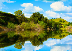 Reflections Of Spring. (scottducey209) Tags: river tuolumne tuolumneriver foothills sierrafoothills waterfordcalifornia centralcalifornia centralvalley sanjoaquinvalley water bluffs trees gaduatednd nikon d5200 1855mm tiffen nature landscape waterscape rural unitedstates hiking fishing route132 stanislauscounty clouds blueskies springtime