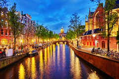 (Voyages Lambert) Tags: nopeople citylife nightlife channel downtowndistrict amstelriver jordaan prinsengracht dusk twilight midsection illuminated waterfront history blue ancient famousplace architecture traveldestinations urbanscene outdoors panoramic westerkerk amsterdam netherlands reflection night lightnaturalphenomenon river water house cathedral church street bridgemanmadestructure builtstructure urbanskyline cityscape town nauticalvessel bicycle