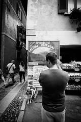 Salumi nostrani (MaxDeVa) Tags: streetphotography nostrani f3545 leica 1123 people lago dog cane ortasangiulio bw supervarioelmart salumi leicat portfolio