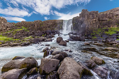 The beautiful Oxarafoss waterfall in Iceland (tvrdypavel) Tags: fall landscape beautiful circle cliff cold driver erosion europe european flow flowing force glacial glacier golden high iceland icelandic landmark mountain national natural nature outdoor oxarafoss oxararfoss panorama park pingvellir powerful reykjanes reykjavik river rock sky splashing spray spring stone stream summer tectonic thingvellir tingvellir tourism travel unesco vacation volcanic water waterfall wild winter world south is