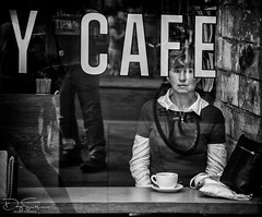 Daydreaming (Daz Smith) Tags: dazsmith canon6d bw blackwhite blackandwhite bath city streetphotography people candid canon portrait citylife thecity urban streets uk monochrome blancoynegro daydrreaming cafe window coffee cup reflections wheel bike walking passerby