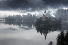 bled slovenia in bad weather (mariusz kluzniak) Tags: mist lake church water rain fog clouds reflections lens island europe zoom sony low super east slovenia bled alpha eastern lenses 580 70400mm a580