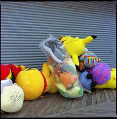 End of season (thereisnocat) Tags: beach newjersey kodak nj pooh stuffedanimals boardwalk 100 prizes oceancounty kiev88 seasideheights ektar picachu