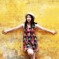 yellow (ojang jerry) Tags: summer portrait hat wall female standing eos 50mm colorful day chinese young sigma skirt yellowwall     upbeat simpleportrait  5d2 gettychinaq4