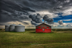 Red Under Grey (Ian McGregor Photography) Tags: canada cloud farm ianmcgregor nikon photography prairie saskatchewan barn bins ianmcgregorphotographycom rural silos storm