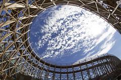 Eye in the sky. Margate (Sean Hartwell Photography) Tags: samyang8mm135fisheyecs samyang8mm samyang 8mm fisheye rollercoaster amusements fairground funfair blue sky eye cloud curves