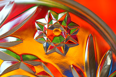 multicolored star (HansHolt) Tags: star ster eightpointed 8pointed octagram bonbonniere lid deksel detail glass glas crystal kristal multicolor veelkleurig reflection reflectie weerspiegeling facet triangle driehoek antique vintage antiek oud flower bloem light licht backlight tegenlicht dof bokeh canon 6d canoneos6d canonef100mmf28macrousm