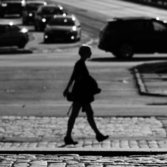 Walking on sunshine (mkorolkov) Tags: street streetphotography sunnyday sunny walk walking brickroad road silhouette blurry blur outoffocus pavement blackandwhite monochrome stepping fujifilm xe1 xc50230