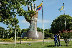 Praying Hands (In Context) (brev99) Tags: prayinghands oru oralrobertsuniversity statue flags entrance couple d7100 sigma185028hsm perfecteffects10 ononesoftware nikoutputsharpener trees leaves grass