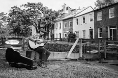 The Georgetowner (Geoff Livingston) Tags: man latino guitar brownstone house brick boat co georgetown