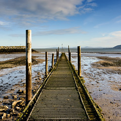 Jetty at Rhos on Sea (Etrusia UK) Tags: uk greatbritain winter sea beach water wales clouds geotagged bay landscapes sand nikon rocks britishisles zoom unitedkingdom britain stones jetty sandy horizon cymru wideangle bluesky pebbles pools squareformat gb lowtide fullframe dslr fx posts d800 rhosonsea colwynbay nikkorlens rhos colwyn 2485mm nikonlens woodenjetty nikon2485mm conwycounty nikkor2485mm nikond800 nikon2485mmlens 2485mmlens nikkor2485mmlens geo:lat=53308916315092695 geo:lon=37383636832237244 vigilantphotographersunite