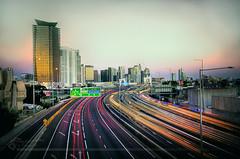 Sunset, heading in to Melbourne (Photography by Darren R) Tags: road city longexposure sunset skyscraper landscape lowlight nikon highway cityscape dusk australia melbourne victoria freeway lighttrail tullamarine bildings d7000 tullafreeway photographybydarrenr
