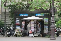 Parisian newstand (tmattioni) Tags: paris france bike newspaper maps streetphotography postcards kiosk magazines newstand parisien canonpowershots95