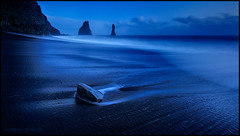 Vk  Mrdal (Andras Gyorosi) Tags: ocean longexposure trip blue beach water island iceland sand blu vik adventure bluehour acqua viaggio spiaggia oceano islanda adventura orablu faraglione d700 gyorosi