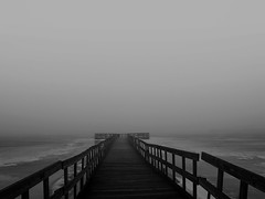 As the ocean surged, the fog rolled in (Explored!) (SCOTTS WORLD) Tags: blackandwhite usa lake water fog fun dock midwest mood unitedstates michigan country atmosphere adventure rainy rails bleak february icy 248 2010 lakeorion 2013 greatlakesstate lakesixteen sonydsc650