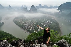 Matt on Laozhai Shan (Marko Stavric) Tags: china old travel houses cloud mist mountain mountains fog clouds river matt liriver li town spring village view bend hiking guilin hike summit limestone april  shan  awe zhai  lao lijiang waterway formations 2010 guangxi  oldvillage awestruck  xingping limestonemountains laozhai