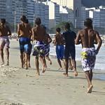 Brazilian boys running on the beach thumbnail