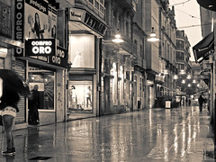 Lluvia y lmparas flotantes [monocromo] (Rodion Quidam) Tags: street longexposure light man reflection building luz mannequin window wet lamp girl monochrome rain shop umbrella awning ventana evening monocromo calle store lluvia cafe wire chica terrace balcony edificio pedestrian cable monochromatic tienda storefront reflejo neonsign showcase paraguas pontevedra balcn hombre terraza shopfront damp cafetera slab soaked lmpara ra mojado toldo escaparate maniqu losa monocromtico largaexposicin peatonal hmedo cartelluminoso canvasshoes tokina28mmf28 zapatillasdelona calledelaoliva radaoliva ralaoliva letreoluminoso