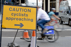 Bow St. 16aug16 (richardbw9) Tags: london uk england city street urban writing words londonstreetphotography cycling sign warning road cycles bikes cyclists crossing bowstreet coventgarden wellingtonstreet russellstreet theatreroyal streetsigh temporary roadworks blur slowshutter motionblur urbancycling bicycle caution approaching arrow trafficcone whitevan sandbag whichway twowaytraffic ambiguoussignage