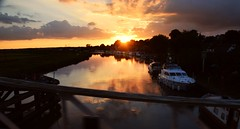 Sunset on the River Yare, Reedham, Norfolk. 29 08 2016 (pnb511) Tags: riveryare norfolk reedham river crossing blue sky water boat swingbridge railway bridge reedhamswingbridge sunset golden light