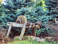 Grindstone (e.m.alder) Tags: 120 645 bronica bronicaetrs c41 canoscan9000f etrs kodak portra portra400 analog film homedevelopment mediumformat waistlevel rural grain grindstone wood texture patina trees pine evergreen work mill stone tools vintage classic old aged mechanical workshop antique