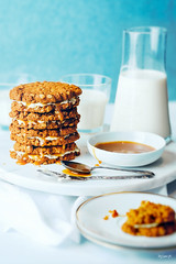 ANZAC biscuit and salted caramel sandwiches (ErinaMak) Tags: caramel fujixt1 dessert sauce sweet milk foodstyling stilllife foodphotography closeup cookie salted biscuit treat anzac tabletop xf56mm cream cheese sandwich