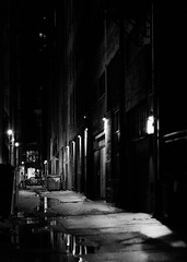 Rainy nights (Blockshadows) Tags: 6d primelens prime 50mm 50mmf12 f12 12 canon industrial wander exploring urban city colorado downtown denver grimey grime sketch moody somber streetphotography street lights reflections reflecting reflection puddle alleyways alleys sharp longexposure nightphotography dark night bw bnw white black