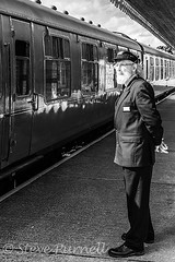 The Stationmaster 3 (Steve Purnell Photography) Tags: stationmaster station travel train transport rail conductor railroad tourism transportation symbol trip employee hat background jacket people tie uniform professional happy safety holiday mustache isolated service old thumb tour person