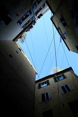 Looking up (Francesca Morgenco) Tags: town buildings sky houses windows flowers alley blue citt edifici cielo case finestre fiori vicolo blu azzurro
