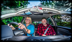 Drive.. . (CWhatPhotos) Tags: photographs photograph pics pictures pic picture image images foto fotos photography artistic cwhatphotos that have which with contain em10 omd olympus esystem four thirds digital camera lens olympusem10 mk ii 43 mft micro samyang wide angle view fisheye fish eye 75mm prime man woman car drive driving smiles smile couple together checked shirt cabin fiat croma estate red hatch