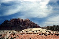 34-212 (ndpa / s. lundeen, archivist) Tags: nick dewolf nickdewolf color photographbynickdewolf 1970s 1973 film 35mm 34 reel34 utah southwestutah southwesternunitedstates zionnationalpark nationalpark mountain mountains sky clouds peak peaks rocks rocky outcropping landscape rock crag