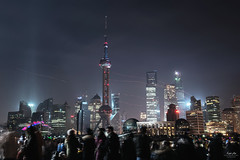 Crowd at The Bund - Shanghai (DOF) (Andy Brandl (PhotonMix.com)) Tags: china city longexposure skyline modern night lights nikon cityscape shanghai action crowd chinese illuminated led celebration future scifi architektur streaks jinmaotower shanghaipudong d800 thebund orientalpearltower swfc shanghaitower shanghaishanghai skylanterns shanghaiworldfinancialcenter architectureshanghai photonmix laoan