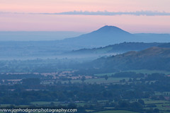 The Wrekin At Dawn (Jon Hodgson Photography) Tags: uk morning trees england mist rural sunrise landscape countryside shropshire pastel hill telephoto fields serene 2012 longmynd wrekin shropshirehills