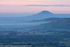 The Wrekin At Dawn (Jon Hodgson Photography) Tags: uk morning trees england mist rural sunrise landscape countryside shropshire pastel hill telephoto fields serene 2012 longmynd wrekin shropshirehills