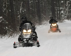 snow sleds on the trail (NorthernMinnesotaPhoto - sweetwaterphotoonline.com) Tags: snow mn sleds snowmobiling itascacounty snomachines