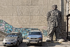 Carpark Coordinator (Fear_Through_The_Eyes) Tags: china street travel art car statue beijing
