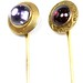 1036. Two Antique Foil Backed Gem Set Stickpins